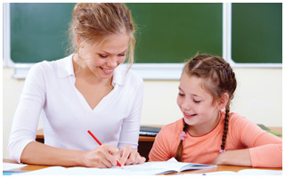 Au Pair hepling child with homework